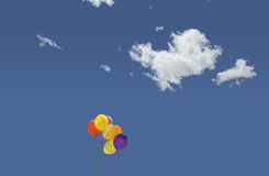 Balloons and clouds Stock Image