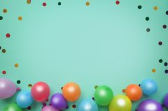 Balloons and confetti on green background. Birthday or party background. Festive greeting card. Balloons and confetti on green background. Birthday or party royalty free stock images