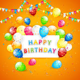 Balloons and confetti on orange background. Birthday background, the inscription Happy Birthday with flying colorful balloons, multicolored pennants and confetti Royalty Free Stock Images