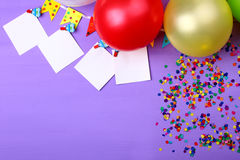 Balloons with confetti. On a purple background Royalty Free Stock Photos