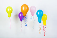Balloons of different bright colors on a white background Stock Photos