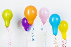 Balloons of different bright colors on a white background Royalty Free Stock Photo