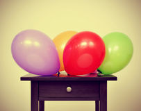 Balloons of different colors on a table Stock Images
