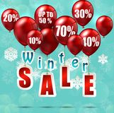 Balloons and discounts on winter sale background Royalty Free Stock Image