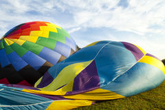 Balloons down. Two hot air balloons on their side Royalty Free Stock Photo