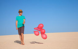Balloons in the dunes Stock Photography
