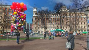 Balloons on Esplanade Helsinki. A man sells balloons on April 30 for Vappu or Well I, one of Finland's biggest celebration Royalty Free Stock Photos