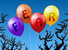 Balloons Fear. Four balloons, which are labeled with the word FEAR, are threatened by thorns Stock Photos