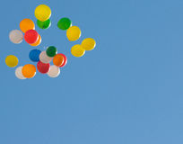 Balloons. Flight of colorful balloons in the sky that can be used to write what you want Stock Photography