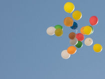 Balloons. Flight of colorful balloons in the sky that can be used to write what you want Stock Images