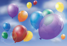Balloons floating in sky Stock Photo