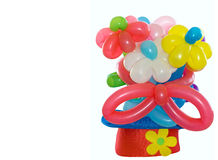 Balloons flowers in a clown hat. Over white background royalty free stock images