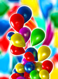 Balloons. Fluttering colored balloons on a colorful background Royalty Free Stock Photo