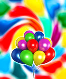 Balloons. Fluttering colored balloons on a colorful background Stock Photo