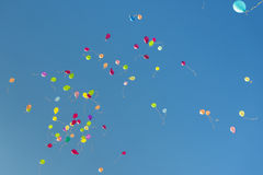 Balloons fly into the blue sky Royalty Free Stock Images