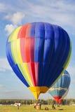 Balloons fly in the blue sky Stock Photos