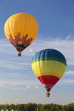 Balloons fly in the blue sky Royalty Free Stock Photo