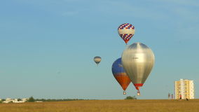 Balloons fly low stock video footage
