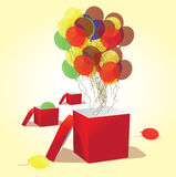 Balloons fly out of the box. Balloons out of the box up in the air Royalty Free Stock Photography