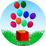 Balloons fly out of gift box on green grass Royalty Free Stock Photos