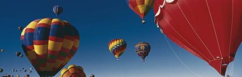 Balloons flying in Albuquerque Balloon Festival royalty free stock image