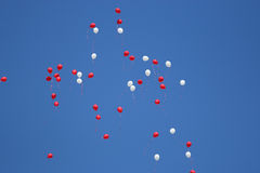 Balloons flying high in the blue sky Stock Image