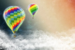 Balloons flying outer space above the clouds. Stock Photo