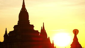 Balloons flying over ancient Buddhist Temple silhouette at Bagan. Myanmar (Burma) stock footage