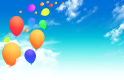 Balloons flying into the sky Stock Photo
