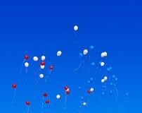 Balloons flying Stock Photos