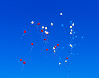 Balloons flying in sky Stock Photography