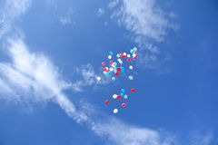 Balloons, flying in the sky Stock Photos