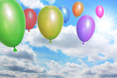 Balloons flying through the sky Royalty Free Stock Photos