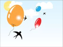 Balloons flying in the sunny sky Royalty Free Stock Photo