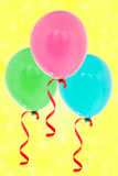 Balloons flying on the yellow background Stock Image