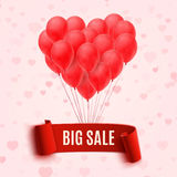 Balloons in form of heart holding big sale red Stock Image