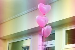 Balloons in the form of a heart. Pink balloons royalty free stock image