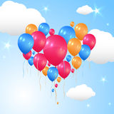 Balloons forming a heart flying in the air Stock Images