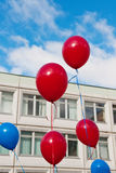 Balloons in front of school building Stock Photography