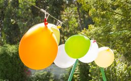 Balloons for games in a childhood garden party stock photography