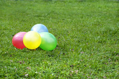 Balloons on a grass Royalty Free Stock Photos