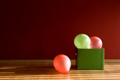 Balloons in green box Stock Photography