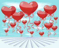 Balloons hearts. Red balloons in the shape of heart flying in blue sky Royalty Free Stock Photography