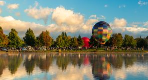 Balloons Henley Lake. Hot air balloons at Henley Lake, Masterton, New Zealand royalty free stock image
