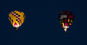 Balloons. Hot Air Balloons glowing in the night Stock Photography
