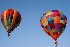 Balloons III. Two colorful hot air balloons shortly after takeoff at The Flying Circus Air Show Hot Air Balloon Festival royalty free stock image