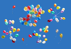 Balloons isolated on blue. Many color balloons isolated on blue Royalty Free Stock Photo
