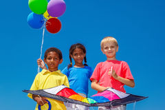 Balloons and a kite Stock Image