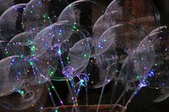Balloons with luminous LEDs. Burning in the dark royalty free stock photography