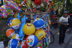 Balloons. Merchants hawked balloons with a bike in the city of Solo, Central Java, Indonesia Royalty Free Stock Images